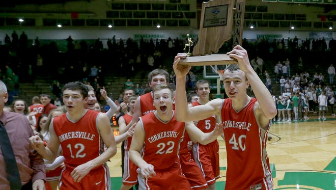 Connersville's Grant Smith (40) celebrates with his teammate their victory in their IHSAA Sectional championship game Saturday, March 4, 2017, evening at the New Castle Chrysler High School Fieldhouse. The Connersville Spartans defeated New Castle 59-44.