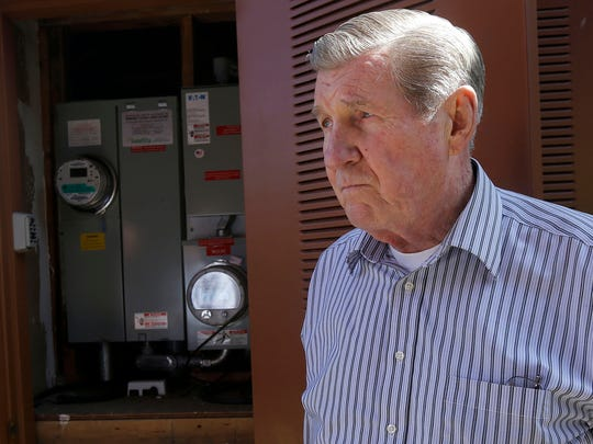 In this April 20, 2015 photo, David Cunningham stands next to power meter at his home in Foster City, Calif. Tesla is expected to unveil a stationary battery for homeowners and businesses on Thursday, April 30, 2015. They will be sold through Tesla's sister company, SolarCity. (AP Photo/Jeff Chiu)