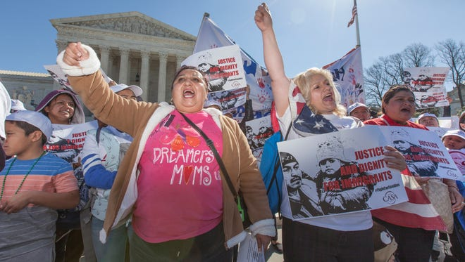 Immigration activists demonstrate at the Supreme Court earlier this year in support of President Obama's executive order to grant relief from deportation in order to keep immigrant families together. The court heard a new immigration case Wednesday.