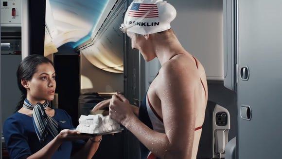 U.S. swimming star Missy Franklin takes a hot towel