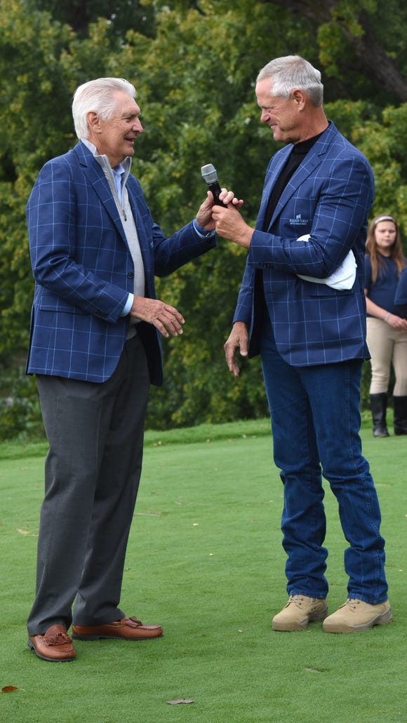 Sanford CEO Kelby Krabbenhoft hands the microphone to Andy North during the Sanford International opening ceremony on Friday, Sept. 21, 2018 in Minnehaha Country Club in Sioux Falls, S.D.