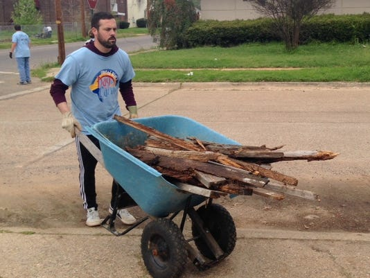 635939160955532870-Enterprise-Employee-moves-old-wood-frames-from-the-garden-at-Common-Ground-during-United-Way-s-Day-of-Caring-March-18..jpg