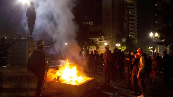 Protesters gather near a fire in downtown Portland July 4.
