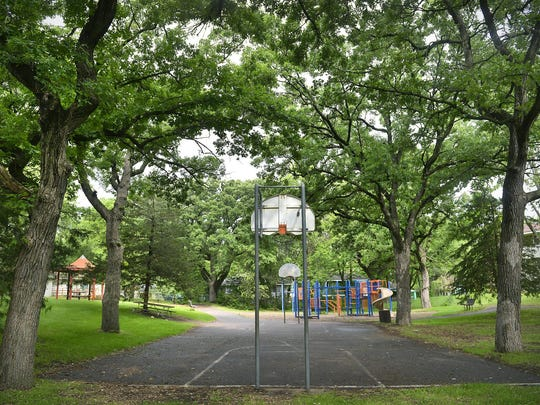 A basketball court is nestled between the mature trees of Goldthorpe Park on Wednesday in St. Cloud.