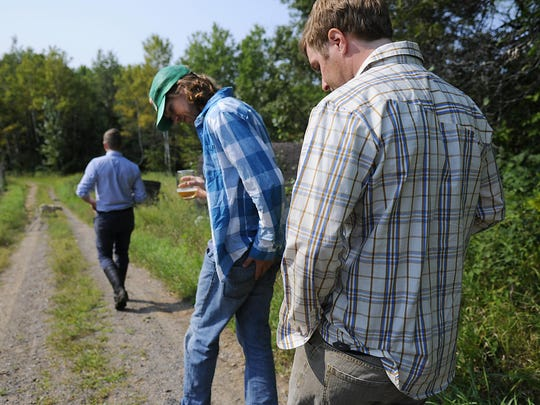 In this 2015 file photo, co-founders of Milk & Honey Cider Peter Gillitzer, back right, Adam Theis, center, and Aaron Klocker, front left, walk towards their cidery in Cold Spring.