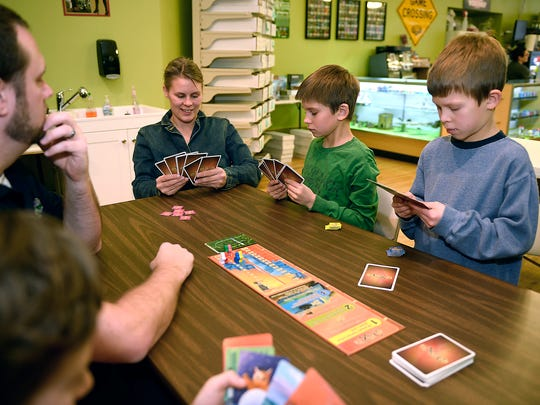 Coya Williams plays a game with her sons Cameron, left, and Hayden, and other families from Cascade County Homeschoolers on Wednesday afternoon at Know Dice.