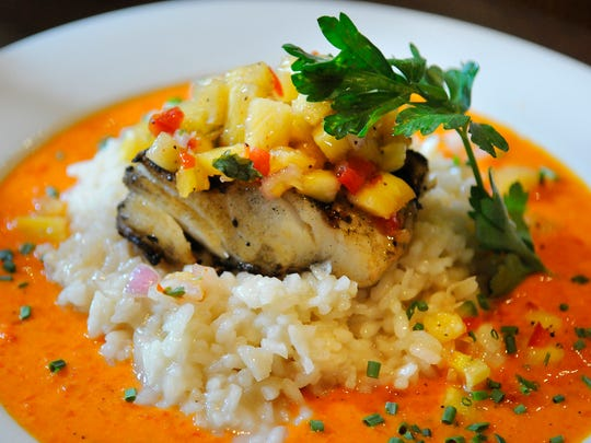 Grilled mahimahi with coconut risotto, red pepper cream sauce and pineapple salsa is pictured Oct. 22  at Ciatti's Ristorante in St. Cloud.