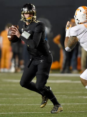 Vanderbilt quarterback Kyle Shurmur (14) drops back to pass in the first half of the game between Vanderbilt and Tennessee at Vanderbilt Stadium Saturday, Nov. 26, 2016, in Nashville, Tenn.