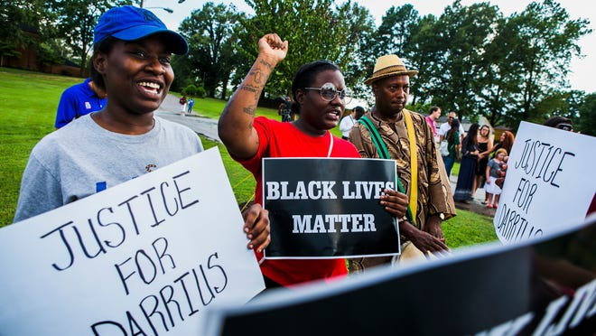July 16, 2016 - (Left to right) Angelic Cathey and Mikelle Cathey hold signs as Ekpe Abioto plays a drum during a vigil honoring the late Darrius Stewart at New Direction Christian Church Youth Campus in Hickory Hill on Friday. Stewart, 19, was fatally shot by Memphis police officer Connor Schilling during a traffic stop on July 17, 2015. His death has influenced the protest movement in Memphis. (Yalonda M. James/The Commercial Appeal)