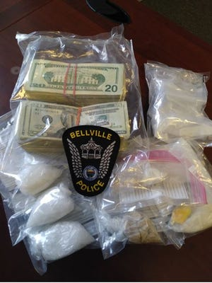 Bellville police Thursday seized suspected drugs, cash, a stolen, loaded firearm and made two arrests during a routine traffic stop on Ohio 97 West near Interstate 71.