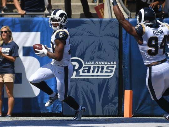Rams cornerback Trumaine Johnson (22) returns an interception for a touchdown against the Colts in the first half of Sunday's game in Los Angeles.