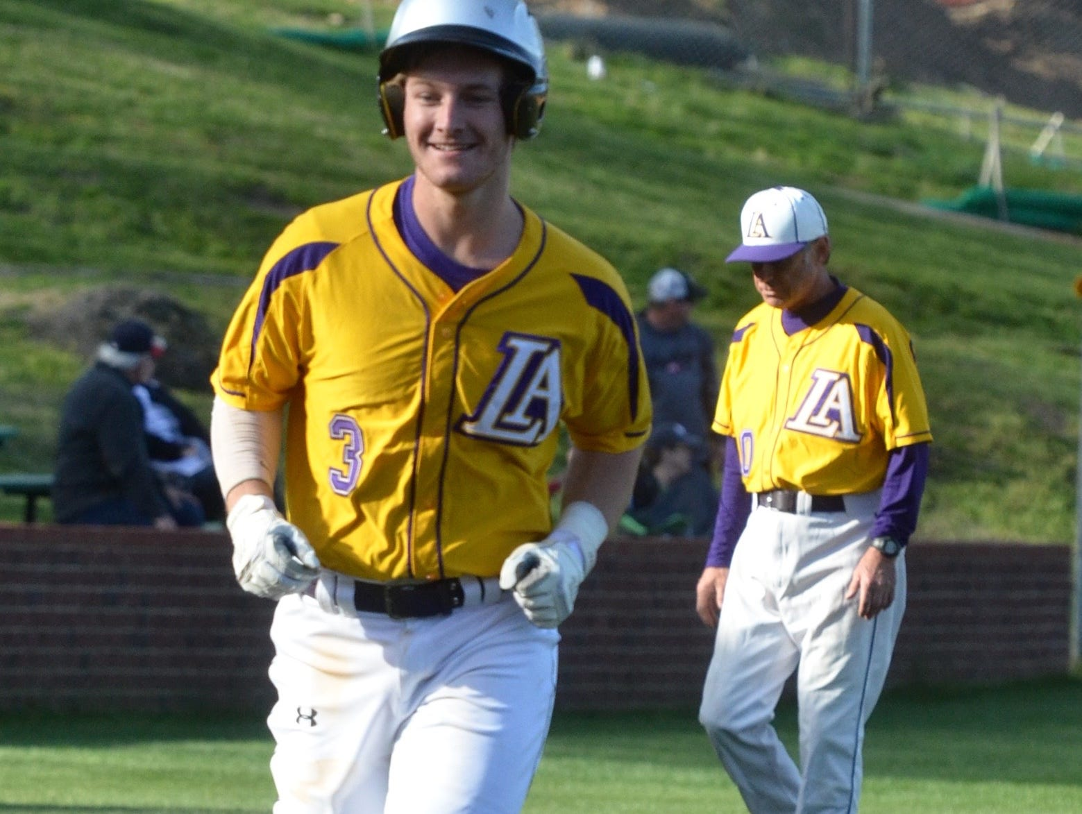 Lipscomb Academy's Andrew Ferrell (3) heads for the plate following his two-run homer during Tuesday's District 10-AA matchup with visiting Hume-Fogg.