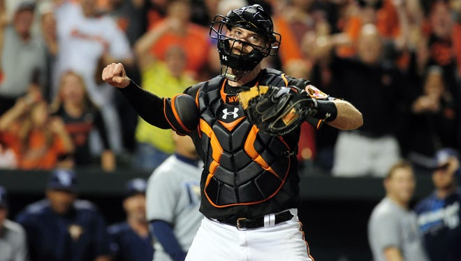 Orioles catcher Matt Wieters (32) reacts after making the tag at home to record the final out to beat the Rays.