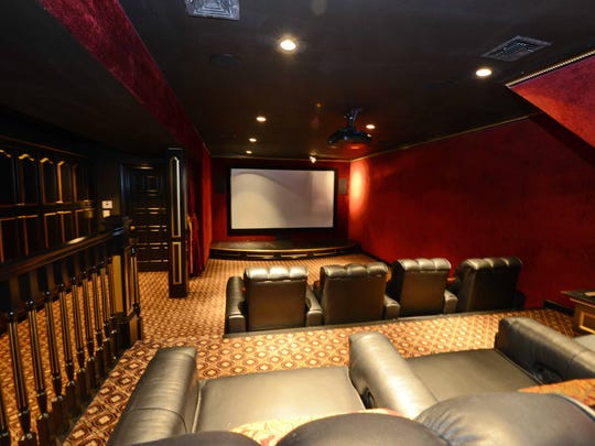 The basement theater with stadium seating at 910 Stonehedge