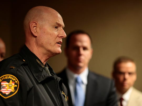 Hamilton County Sheriff Jim Neil speaks about the added value of federal charges over state charges during a news conference Tuesday at the Downtown Cincinnati offices of U.S. Attorney Carter Stewart. Federal charges carry more prison time and remove habitual criminals from their local networks, according to Neil.
