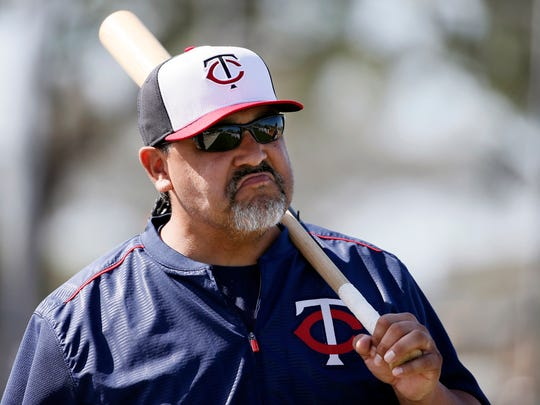 FILE - In this Tuesday, March 3, 2015, file photo, Minnesota Twins bullpen coach Eddie Guardado talks with a player standing nearby during a workout at baseball spring training in Fort Myers, Fla. Long before any of that major league money starts landing in their bank accounts, most players are in a similar spot as everyone else in the regular workforce. Twins bullpen coach Eddie Guardado gained that perspective at a bait shop in his Stockton, California when his major league career was just beginning.  (AP Photo/Tony Gutierrez, File)