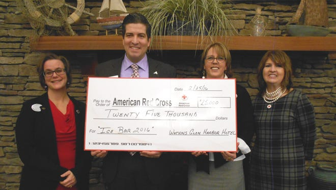 The Watkins Glen Harbor Hotel presents the Finger Lakes Chapter of the American Red Cross with a donation of $25,000 from the proceeds of January's annual Ice Bar. From left, Christine Peacock, Harbor Hotel director of sales; Red Cross Chapter Executive Director Carlos McCluskey; Carolyn Guyer, Harbor Hotel general manager; and Betsy Morrisey, major gifts officer for the Finger Lakes Chapter.