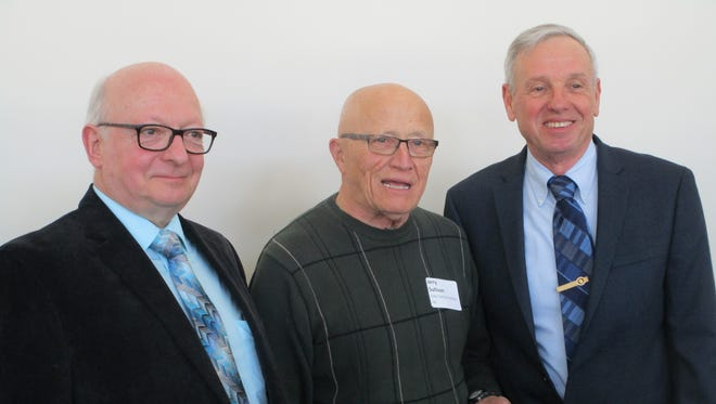 Pictured left, Bob Hartzheim, president of the Fond du Lac County Council of St Vincent de Paul, center, Jerry Sullivan, member of Holy Family Conference, receiving the award and right, Jim Hafenstein, president of the Archdiocesan Council of the St Vincent de Paul presenting the award.