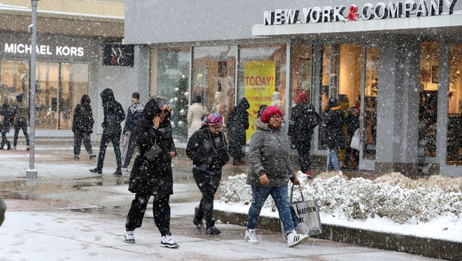 Shoppers brave the snow at the Cross County Shopping Center in Yonkers, Dec. 9, 2017.
