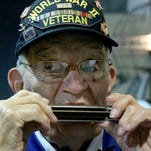93-year-old WWII vet strikes patriotic chord with his harmonica