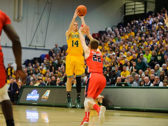 Vermont's Cam Ward (14) shoots a three pointer during
