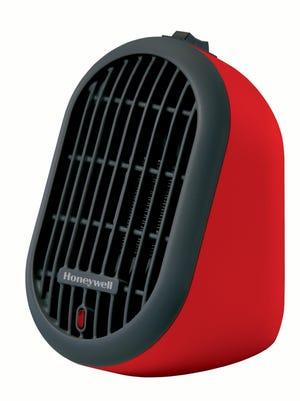 Honeywell's tiny Heat Bud HCE100 personal heater can warm you up using only 250 watts of energy at the high setting.