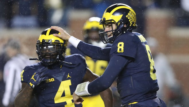 Michigan RB De'Veon Smith and QB John O'Korn celebrate his touchdown against Indiana during the second half of U-M's 20-10 win Saturday in Ann Arbor.