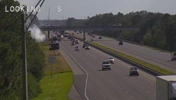 A car crashed and caught fire on the shoulder of northbound Interstate 95 in the Grant-Valkaria area Wednesday.