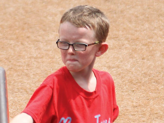 Kaiser Carlile, 9, was serving as a batboy during the
