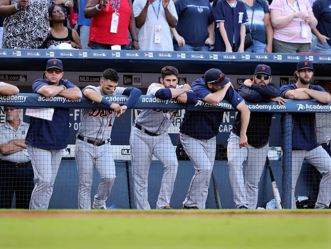Detroit Tigers players look onto the field after falling