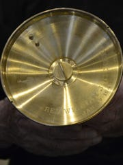 The bottom of the golden chalice given to the Rev.