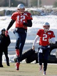 New England Patriots quarterbacks Tom Brady (12) Brian