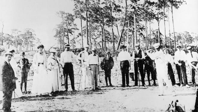 People gather at Fort Myers Yacht and Country Club to play and watch golf in the early 1900s.