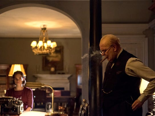 "Lily James stars as Elizabeth Layton and Gary Oldman as Winston Churchill in director Joe Wright's ""Darkest Hour."""