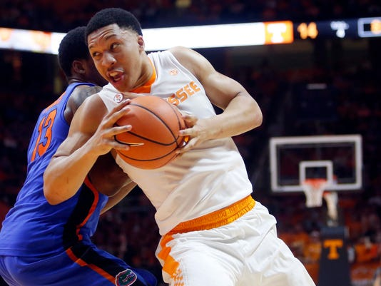 FILE - In this Feb. 21, 2018, file photo, Tennessee forward Grant Williams (2) drives the ball around Florida forward Kevarrius Hayes (13) during the first half of an NCAA college basketball game in Knoxville, Tenn. Williams was selected to the AP All-SEC team on Tuesday, March 6, 2018. (AP Photo/Crystal LoGiudice, File)