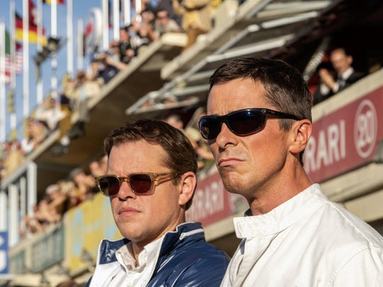 "This image released by 20th Century fox shows Christian Bale, right, and Matt Damon in a scene from ""Ford v. Ferrari,"" in theaters on Nov. 15. (Merrick Morton/20th Century Fox via AP)"