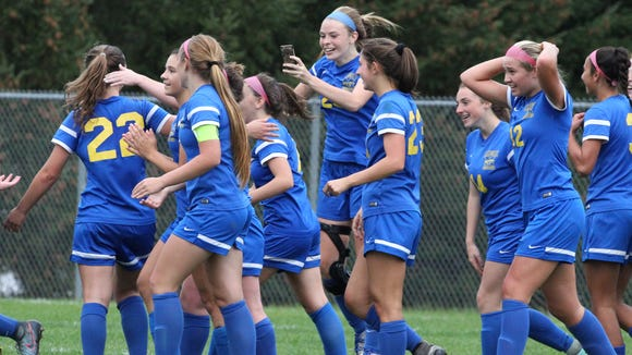 Mahopac' players celebrate their 2-1 win in a Section 1 Class AA girls soccer quarterfinal at North Rockland Oct. 25, 2017.
