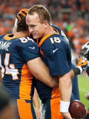 DENVER, CO - OCTOBER 19:  Quarterback Peyton Manning #18 of the Denver Broncos celebrates his record-breaking 509th career touchdown pass on the sideline with tight end Jacob Tamme #84 during a game against the San Francisco 49ers at Sports Authority Field at Mile High on October 19, 2014 in Denver, Colorado.  (Photo by Dustin Bradford/Getty Images)