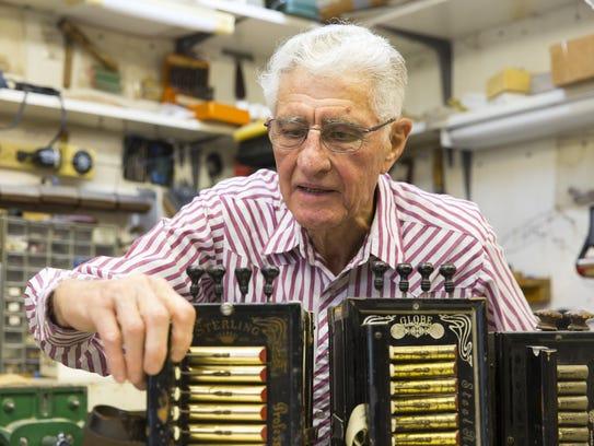Accordion maker Larry Miller works on a pre-World War
