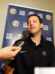 Vanderbilt head coach, Bryce Drew, speaks with reporters