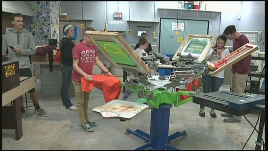 Local students printing broncos championship t shirts for Local t shirt printing company