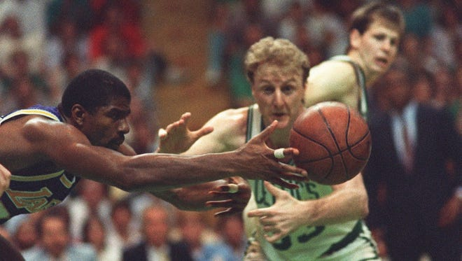 Magic Johnson of the Los Angeles Lakers battles the Boston Celtics' Larry Bird for a loose ball during Game 4 of the 1987 NBA Finals at the Boston Garden.