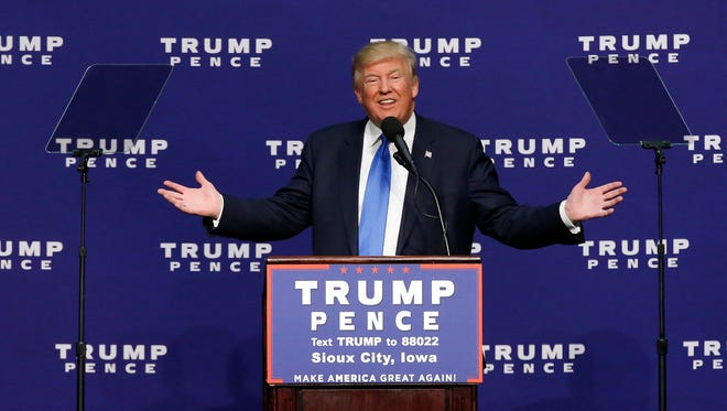 Republican President-elect Donald Trump speaks at a campaign rally in Sioux City.