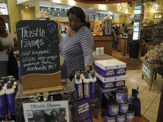 Katrina Roberston sells Thistle Farms products