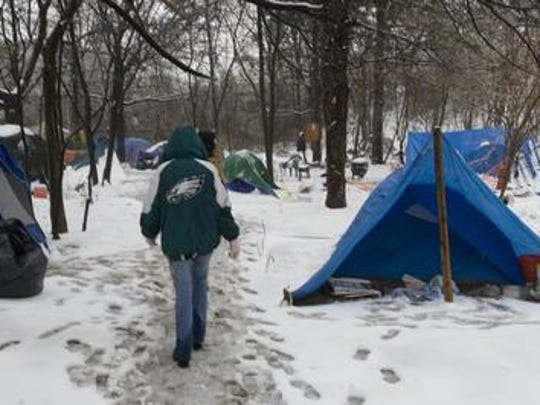 A man who served Camden's homeless community, which once included this 2009 encampment, is accused of operating a drug market on an East Camden street.