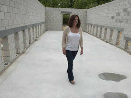 """Camden County Freeholder Michelle Gentek-Mayer walks through part of the expansion at the Camden County Animal Shelter in May. """"Our shelter and the county animal alliance members are constantly at capacity for housing cats and dogs and these pets need to be a resident's first choice for a loving home,"""" Gentek-Mayer said."""