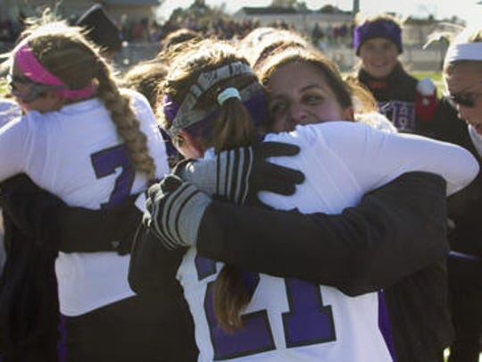 Madison Maguire embraces coach Julie Brewington after Rumson-Fair Haven field hockey won the Group II title last November.
