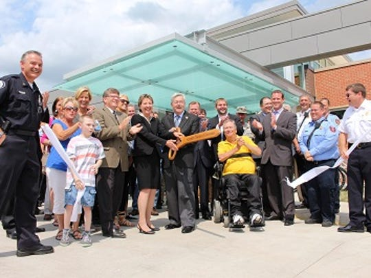 Johnston Police Chief Bill Vaughn. left, attends  a ribbon-cutting ceremony for the new Johnston Public Safety Building.