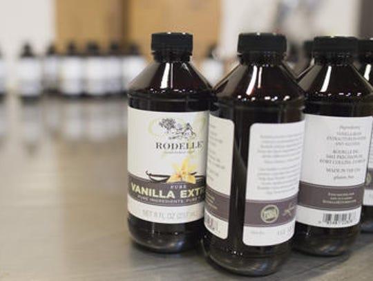 Bottles of vanilla await packaging on the bottling