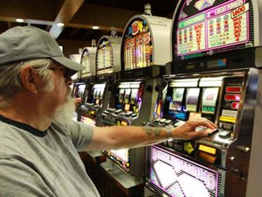 Prairie Meadows introduced 1,100 slot machines to its facilities in 1995, which were an immediate success, bailing out the track from its financial woes. Pictured: Mike Deimerly of New Mexico playing slots at Prairie Meadows Racetrack and Casino in 2010.